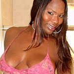 Aubria0. Black tranny Aubria oils up her big boobs and thick cock