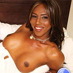 Paris3. Paris is a stunningly charming black tranny with soft boobs and a long penish hiding beneath her white dress